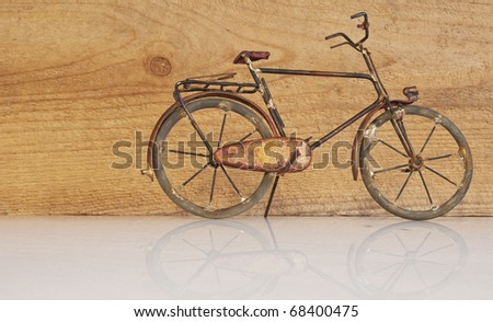 Bicycle in front of a wooden wall - stock photo