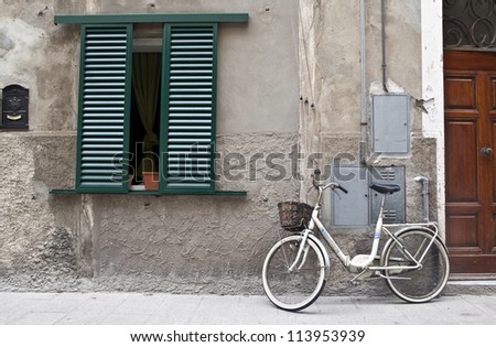 Bicycle in italian street - stock photo
