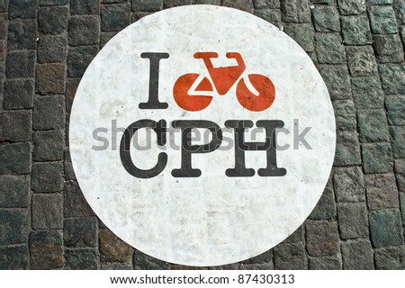 Bicycle lane sign on a bricked street of Copenhagen, Denmark - stock photo