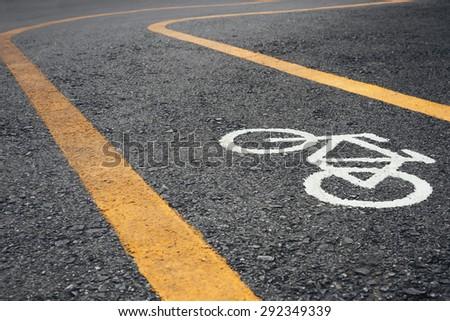 Bicycle lane signage on street  - stock photo