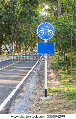 bicycle lane with a blue sign