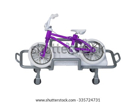 Bicycle laying on a hospital gurney to show that injuries can occur - path included - stock photo