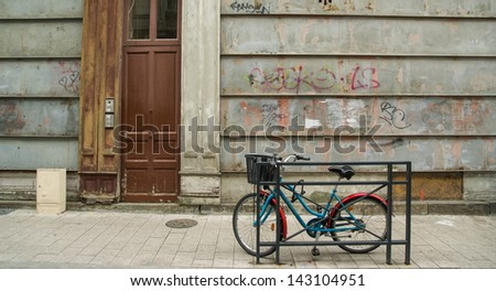 Bicycle Leaning on Railing - stock photo