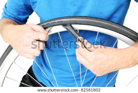 Bicycle maintenance. Fixing a flat tyre. - stock photo