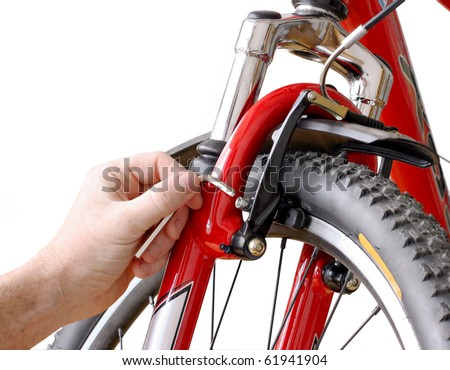 Bicycle maintenance- fixing the front brakes on a mountain bike - stock photo