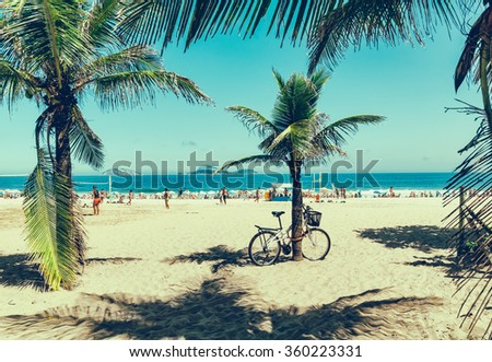 Bicycle near palm on the Ipanema beach in Rio de Janeiro. Brazil - stock photo