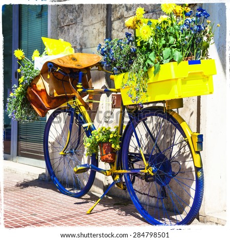 Bicycle of postman -charming street decoration - stock photo