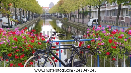 bicycle on a bridge with blooming flowers in The Hague, netherlands - stock photo
