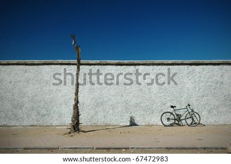 bicycle on a wall - stock photo