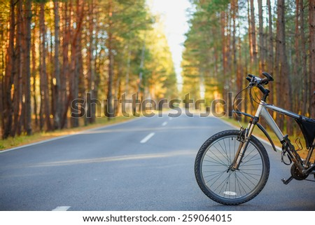 bicycle on an asphalt road. travel concept - stock photo