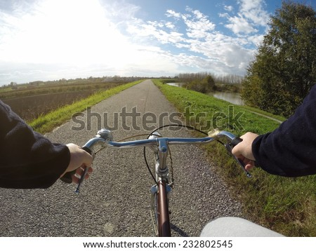 Bicycle on city street in the country in the autumn day - stock photo