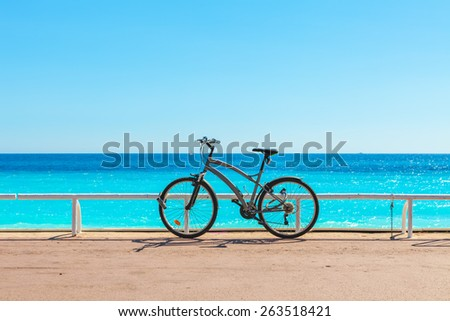 Bicycle on famous Promenade des Anglais as Mediterranean sea on background in Nice, France. - stock photo