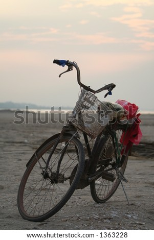 Bicycle on the banks of the Mekong - Laos - stock photo