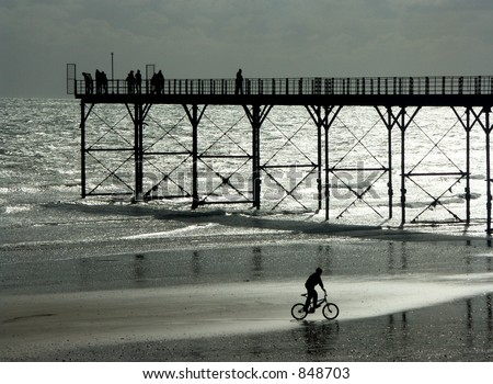 Bicycle on the beach at Bognor Regis, Sussex, England - NOISE IN SKY - stock photo