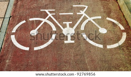 bicycle-only lane sign painted on the street - stock photo