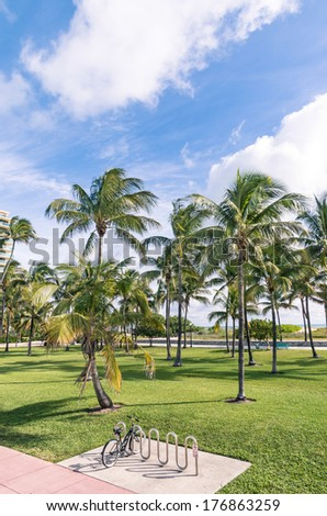 Bicycle parked along Ocean Drive - Miami Florida - stock photo