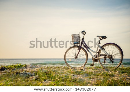 Bicycle parked in paradise island - stock photo