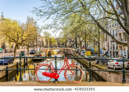 Bicycle parked on a bridge in Amsterdam, Netherlands