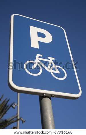 Bicycle Parking Sign against Blue Sky Background