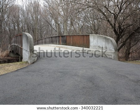 Bicycle Path and bridge in a  suburban park. - stock photo