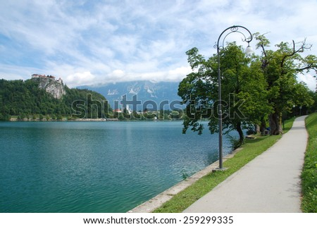 Bicycle path around Lake Bled Slovenia Julian Alps - stock photo