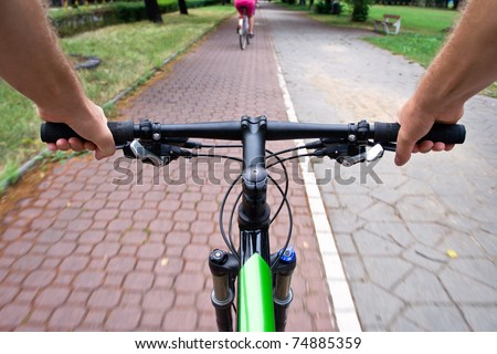 Bicycle path rider, motion blur, commuting to work - stock photo