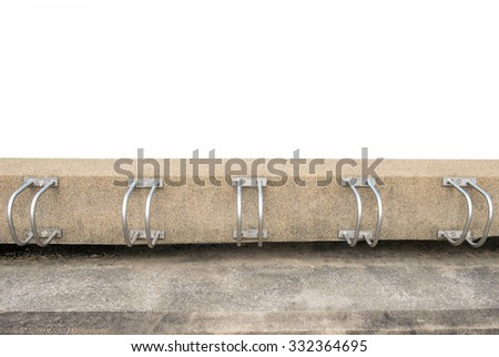Bicycle racks in bicycle parking facility isolated on white background. - stock photo