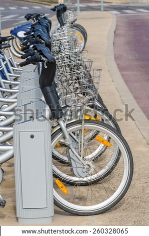 Bicycle rental station in a city, zero emission transport - stock photo