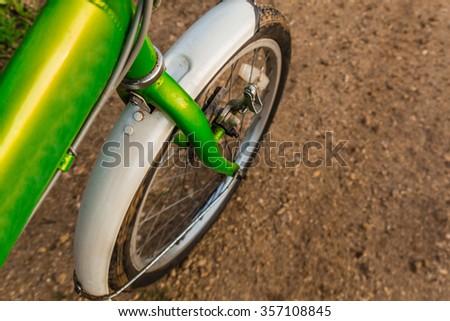 Bicycle ride through muddy dirt road   - stock photo