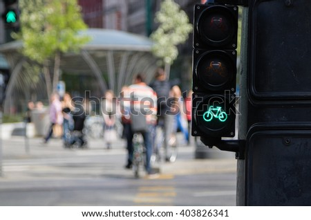 Bicycle riders waiting for traffic light sign to allow crossing street - stock photo