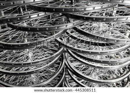 Bicycle rims put in rows in manufacturer house. - stock photo