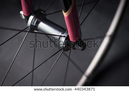 Bicycle road bike front wheel - stock photo