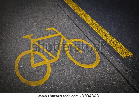 Bicycle road mark in a grey asphalt - stock photo