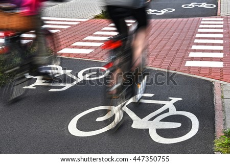 Bicycle road sign and bike riders.  - stock photo