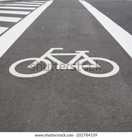 Bicycle road sign on the  road. - stock photo