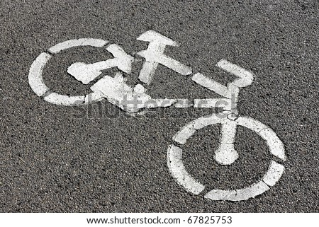 Bicycle road sign painted on the pavement.