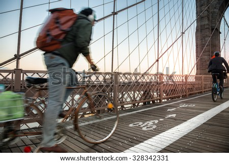 Bicycle road with cyclist on Brooklyn Bridge in New York City - stock photo