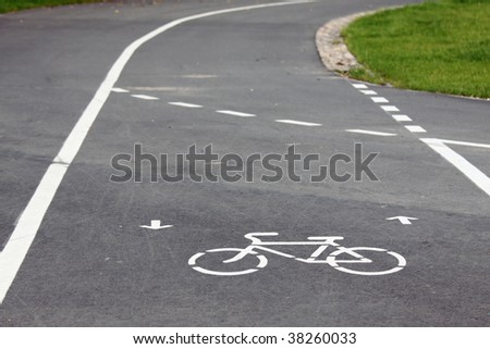 Bicycle route sign on the road and arrows pointing direction - stock photo