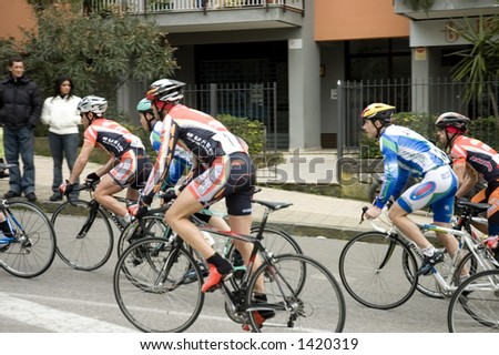 Bicycle's rally in Sorrento street, Italy. Focus on the first racer. - stock photo