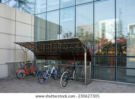 bicycle shed in modern building - stock photo