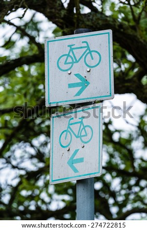 Bicycle sign in the park - bicycle lane continuing to the left and to the right - stock photo