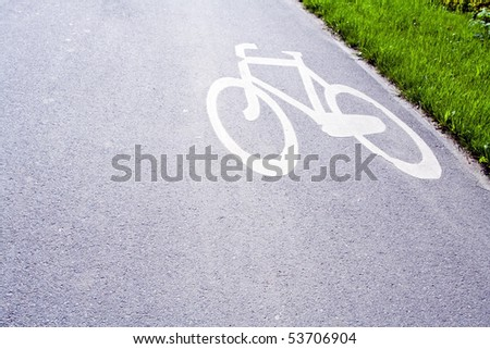 Bicycle sign on bike path in city - stock photo