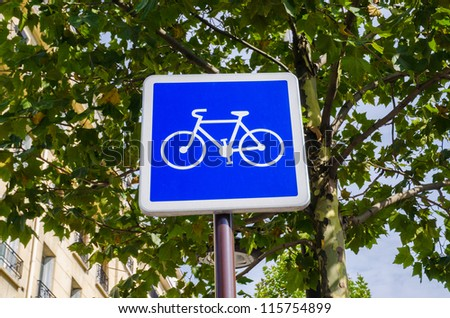 Bicycle sign on blue background