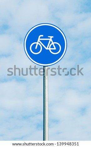 Bicycle sign on blue sky - stock photo