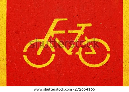 Bicycle sign on red bicycle lane - stock photo