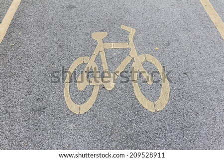 bicycle sign on the cement road - stock photo