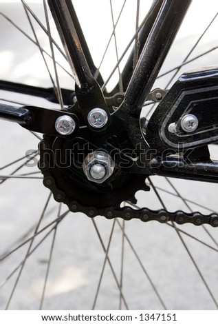 Bicycle spokes and gears - stock photo