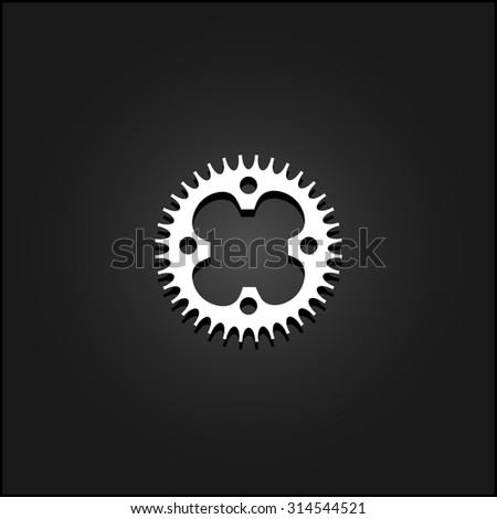 Bicycle sprocket. White flat simple icon illustration with shadow on a black background. Symbol for web and mobile applications for use as logo, pictogram, icon, infographic element - stock photo
