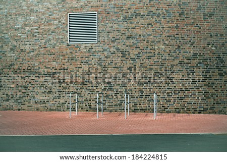 Bicycle stand on a supermarket parking lot, modern city architecture - stock photo