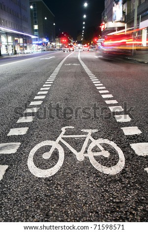 Bicycle symbol on city street in the evening - stock photo